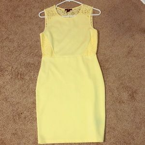 Mid length form fitting yellow lace dress